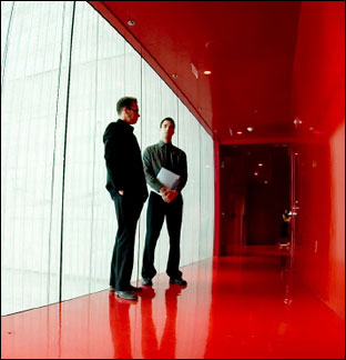 Men in Red Hallway